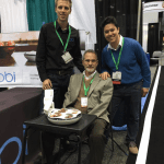Obi team demonstrates their robotic feeding device at the AOTA Expo.